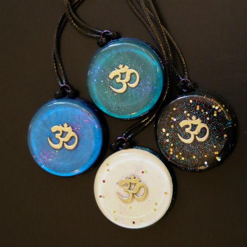 Om Orgonite pendants Group